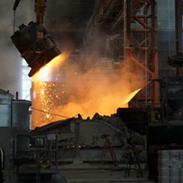 A Factory With Smoke Coming Out Of A Fire