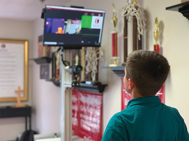 A Person Standing In Front Of A Television