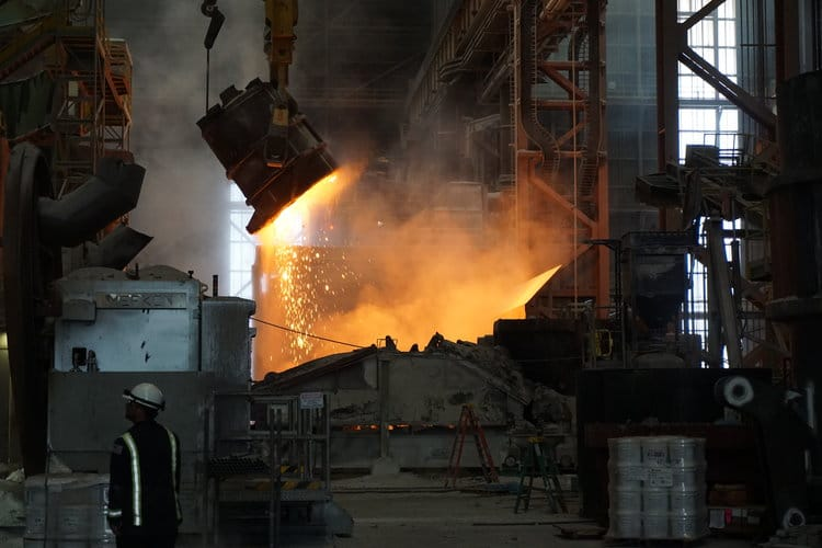A Factory With Smoke And Fire