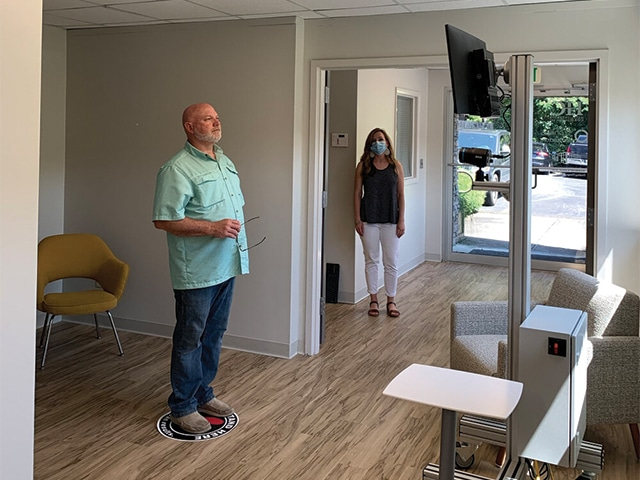 A Man And A Woman Standing In A Room
